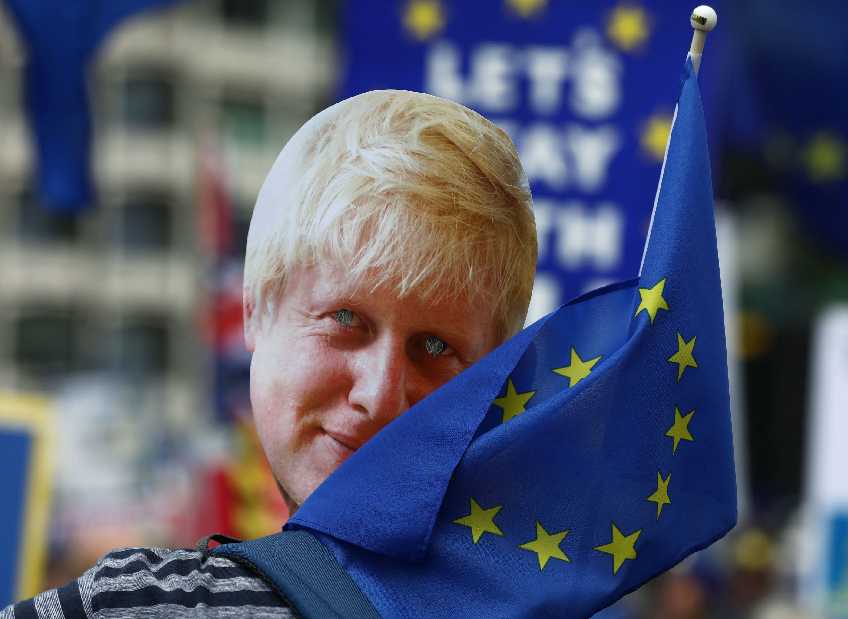 A protester wearing a mask depicting Boris Johnson attends an anti-Brexit 'No to Boris, Yes to Europe' march in London, Britain July 20, 2019.