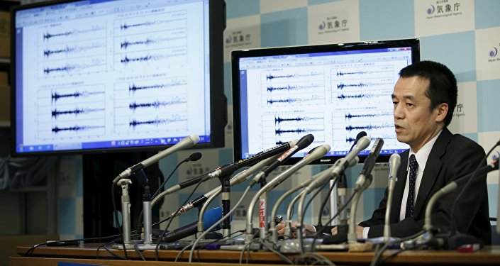 Japan Meteorological Agency's earthquake and tsunami observations division director Yohei Hasegawa speaks next to graphs of ground motion waveform data observed in Japan during a news conference at the Japan Meteorological Agency in Tokyo on implications that an earthquake sourced around North Korea was triggered by an unnatural reason January 6, 2016