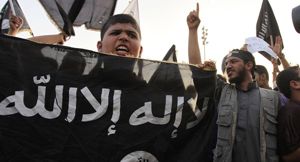 In this Friday, Sept. 14, 2012 file photo, Libyan followers of Ansar al-Shariah Brigades chant anti-U.S. slogans during a protest in front of the Tibesti Hotel, in Benghazi, Libya, as part of widespread anger across the Muslim world about a film ridiculing Islam's Prophet Muhammad
