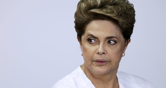 Brazil's President Dilma Rousseff looks on during signing of federal land transfer agreement for the government of the state of Amapa at Planalto Palace in Brasilia, Brazil, April 15, 2016