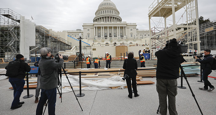 Members of the media document workers on Capitol Hill in Washington, Thursday, Dec. 8, 2016, as construction continues on the Inaugural platform in preparation for the Inauguration and swearing-in ceremonies for President-elect Donald Trump