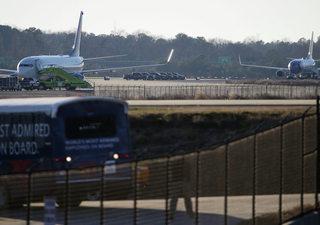 A Delta airplane at left and a Southwest airplane at right sit on the tarmac at Hartsfield-Jackson Atlanta International Airport, Saturday, Jan. 24, 2015, in Atlanta.