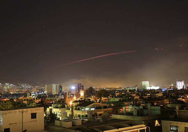 Damascus skies erupt with anti-aircraft fire as the U.S. launches an attack on Syria targeting different parts of the Syrian capital Damascus, Syria, early Saturday, April 14, 2018. Syria's capital has been rocked by loud explosions that lit up the sky with heavy smoke as U.S. President Donald Trump announced airstrikes in retaliation for the country's alleged use of chemical weapons.