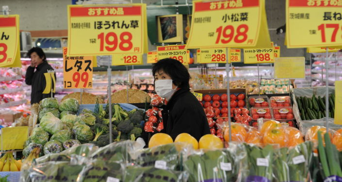 A woman walks past vegetables dsplayed at a supermarket in Nihonmatsu, Fukushima prefecture on March 26, 2011.  Lettuce contaminated with radiation above the legal limit has been found at a wholesale market in central Japan, shipped from a farm north of Tokyo, officials said.