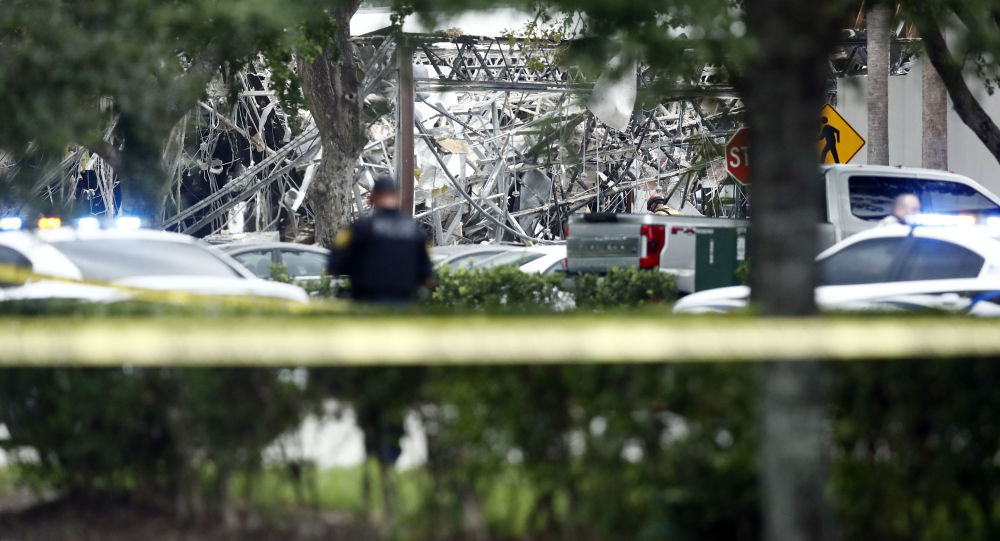 A police officer guards the area after a gas explosion at Florida shopping plaza
