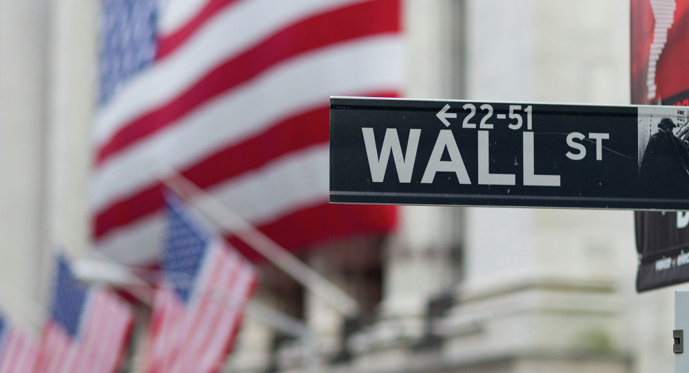 A Wall Street sign hangs near the New York Stock Exchange.