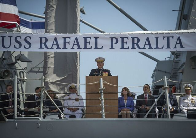 Commandant of the Marine Corps, Gen. Robert B. Neller, delivers remarks during the commissioning ceremony for the Navy's newest Arleigh Burke-class guided-missile destroyer, USS Rafael Perlata (DDG 115). DDG 115 is named in honor of Navy Cross recipient Sgt. Rafael Peralta, a scout team leader assigned to the Lava Dogs of Company A, 1st Battalion, 3rd Marine Regiment. During the second battle of Fallujah, his team was ordered to clear houses as part of Operation Phantom Fury. On that mission his team came under heavy insurgent AK-47 fire and a grenade attack. Sgt. Peralta smothered the grenade with his body, absorbing the majority of the lethal blast and shrapnel, killing him instantly, but saving the lives of his fellow Marines.