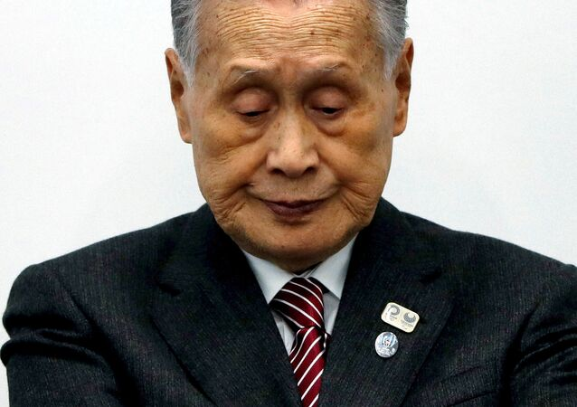 FILE PHOTO: Yoshiro Mori, President of the Tokyo 2020 Olympic Games Organising Committee, attends a news conference in Tokyo, Japan March 23, 2020. REUTERS/Issei Kato/File Photo