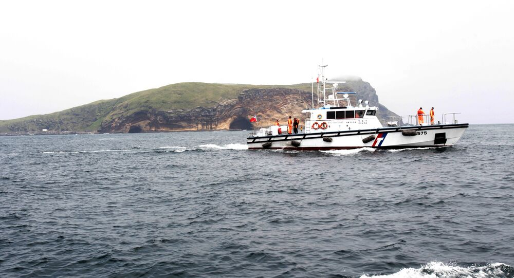 Taiwan Coast Guard's vessel patrols during Taiwanese President Ma Ying-jeou's visit to Pengjia Islet in the East China Sea, north of Taiwan, Saturday, April 9, 2016.