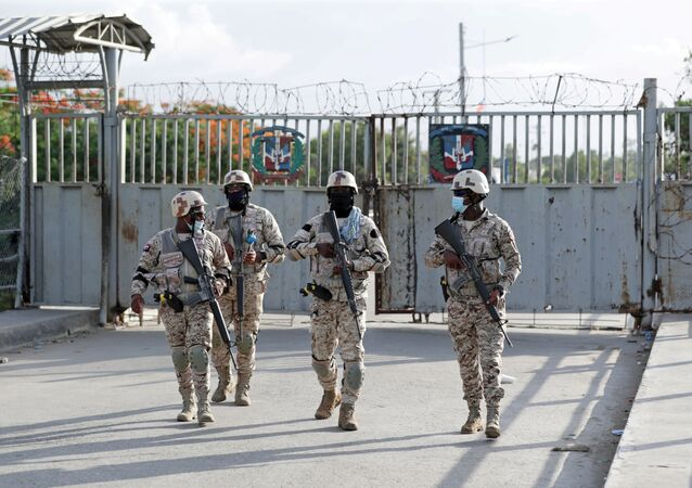 Members of the Dominican Republic's National Army guard the bridge between the Dominican Republic and Haiti, after the shared border was closed when Haiti's President Jovenel Moise was shot dead by gunmen at his private home in Port-au-Prince, in Dajabon, Dominican Republic July 7, 2021.