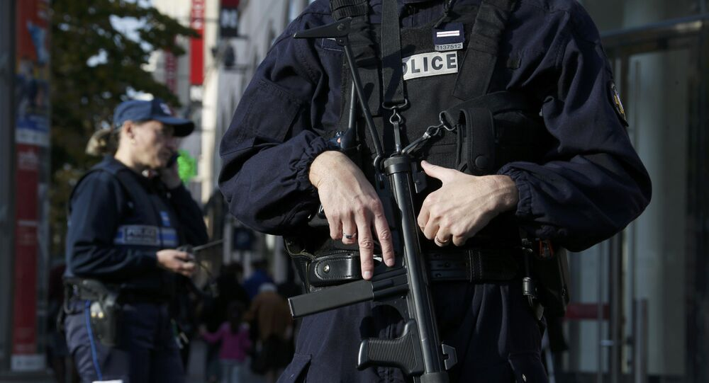 Armed French police stand guard outside a commercial center in Nice, France, November 14, 2015, the day after a series of deadly attacks in Paris