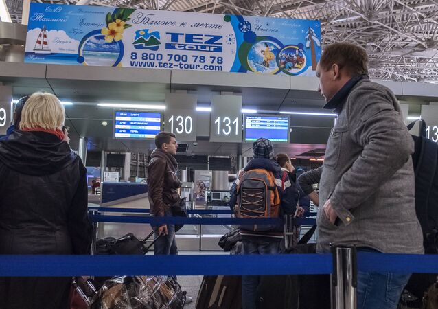 Passengers at the registration desk at Vnukovo airport, Moscow