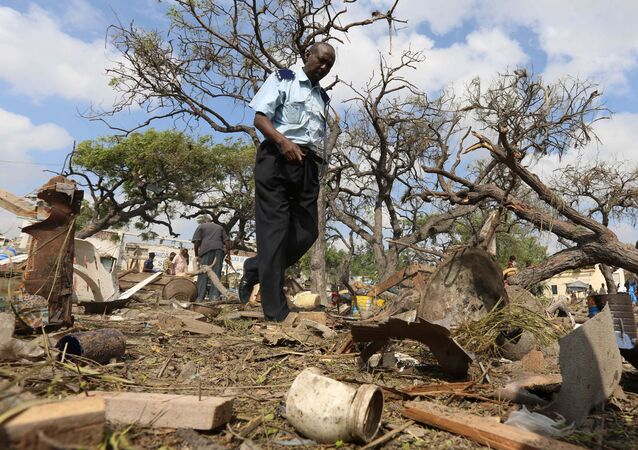 A security officer walks past a temporary stall destroyed after a suicide car bomb went off at the entrance of Somalia's biggest port in its capital Mogadishu December 11, 2016