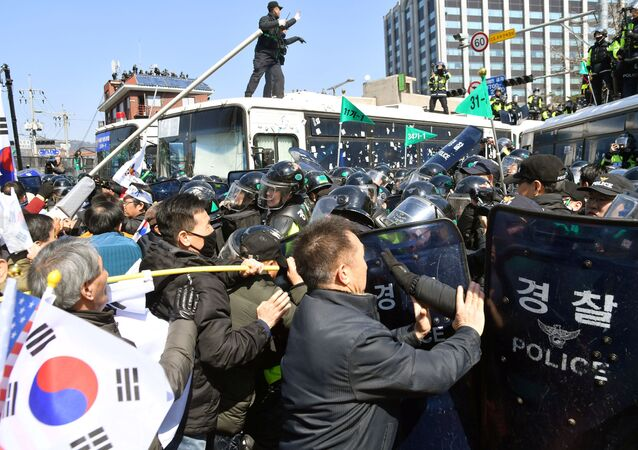 Protesters supporting South Korean President Park Geun-hye clash with riot policemen near the Constitutional Court in Seoul, South Korea, in this photo taken by Kyodo on March 10, 2017