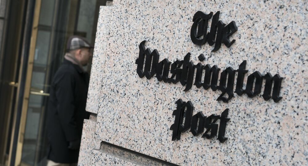 A man walks into the Washington Post's new building March 3, 2016 in Washington, DC