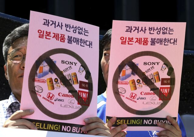 South Korean merchants attend a rally to denounce Japanese government's decision on export to South Korea in front of the Japanese embassy in Seoul