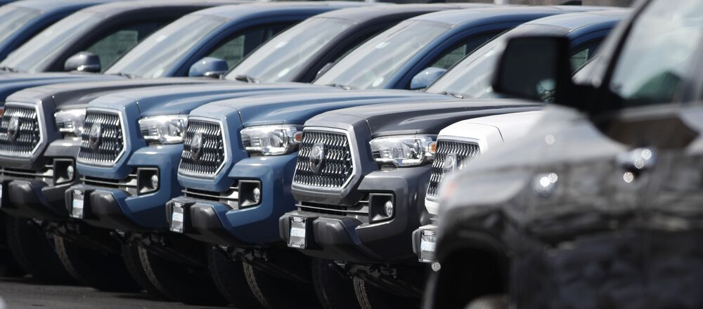 In this Wednesday, Feb. 27, 2019, file photograph, a long row of unsold 2019 Tacoma pickup trucks sits at a Toyota dealership in Lakewood, Colo. On Wednesday, March 13, the Commerce Department releases its January report on durable goods