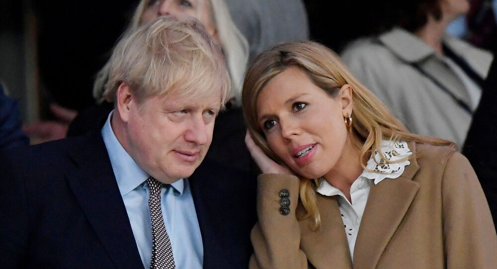 Rugby Union - Six Nations Championship - England v Wales - Twickenham Stadium, London, Britain - March 7, 2020  Britain's Prime Minister Boris Johnson with his partner Carrie Symonds after the match